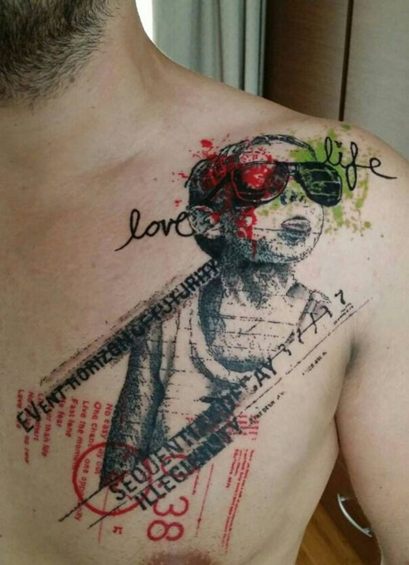 Unusual style painted colored funny boy with lettering tattoo on chest