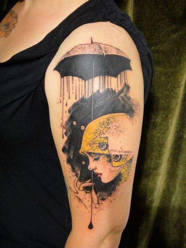 Unusual style painted woman with unusual umbrella tattoo on shoulder