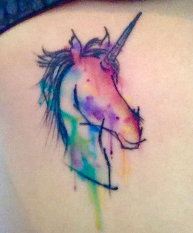 Unusual unicorn rainbow colored tattoo in watercolor style