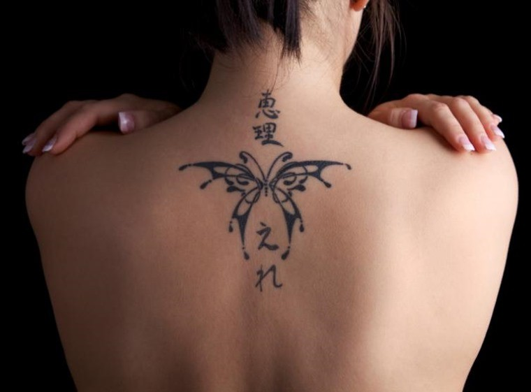 Upper back small butterfly tattoo for women