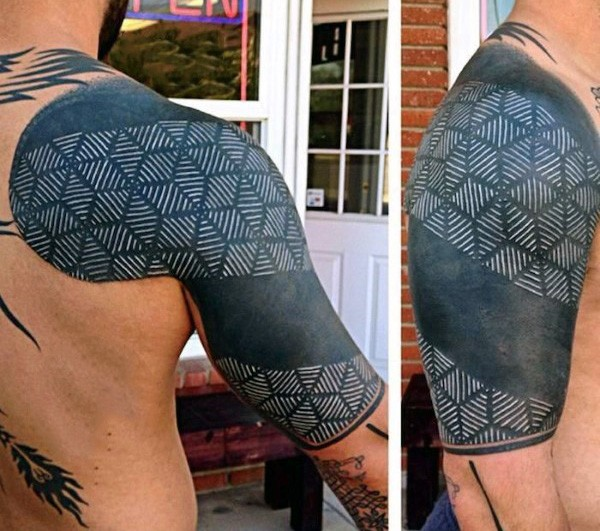 Usual black and white on shoulder tattoo of tribal pattern