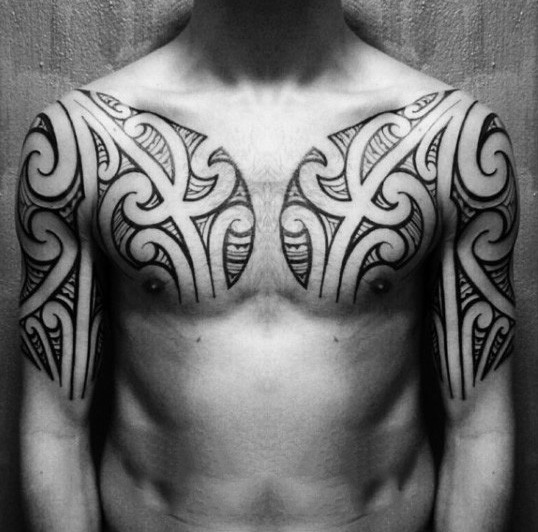 Usual black ink tribal style tattoo on chest and upper arm