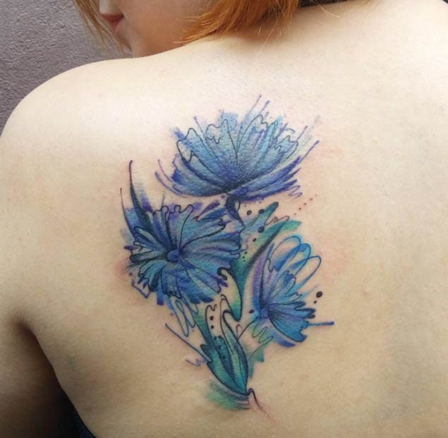 Usual blue colored beautiful flowers tattoo on shoulder