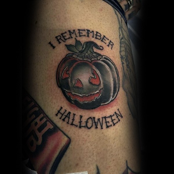 Usual colored accurate looking black pumpkin tattoo on side with lettering