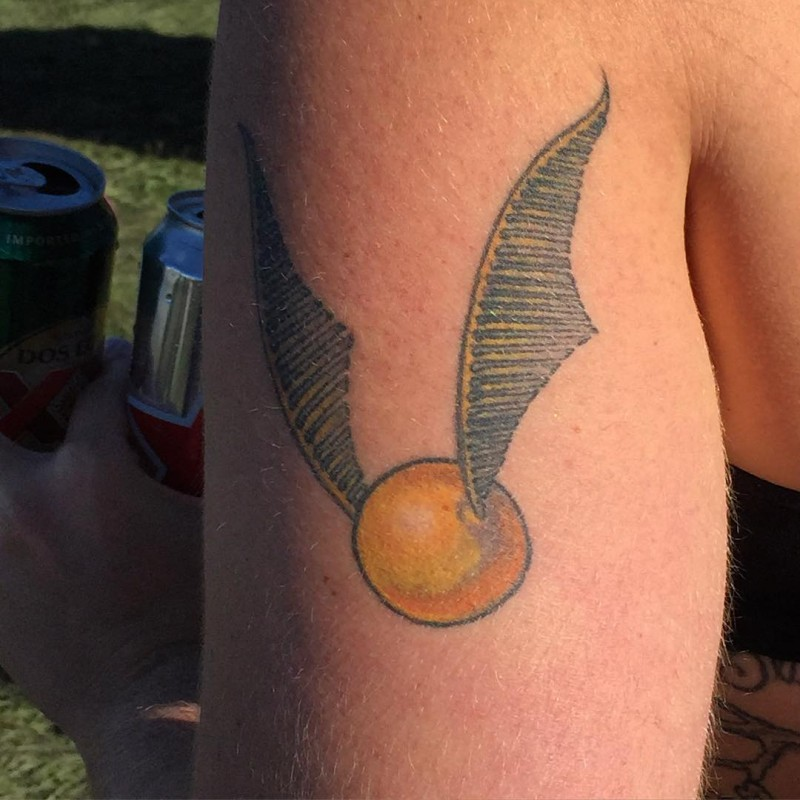 usual colored big detailed shoulder tattoo on quidditch