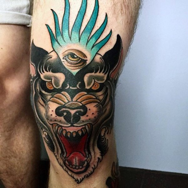 Usual designed and colored knee tattoo of demonic dog and eye