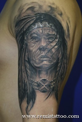 Usual designed black ink old Indian portrait tattoo on half sleeve zone