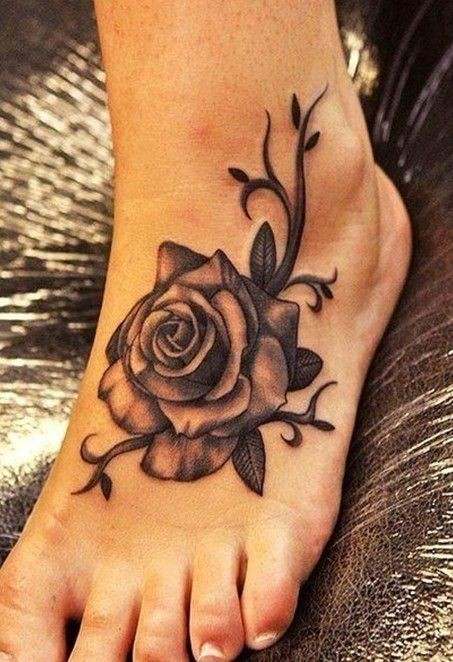 Usual designed little black and white detailed rose flower on foot