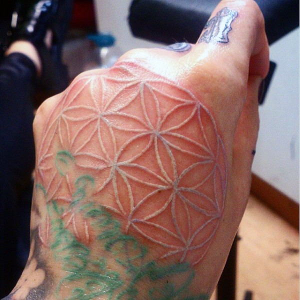 Usual designed white ink ornament tattoo on hand
