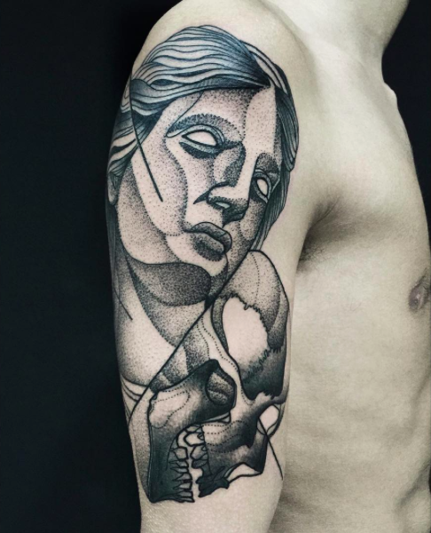 Usual dot style upper arm tattoo of woman statue with skull by Michele Zingales