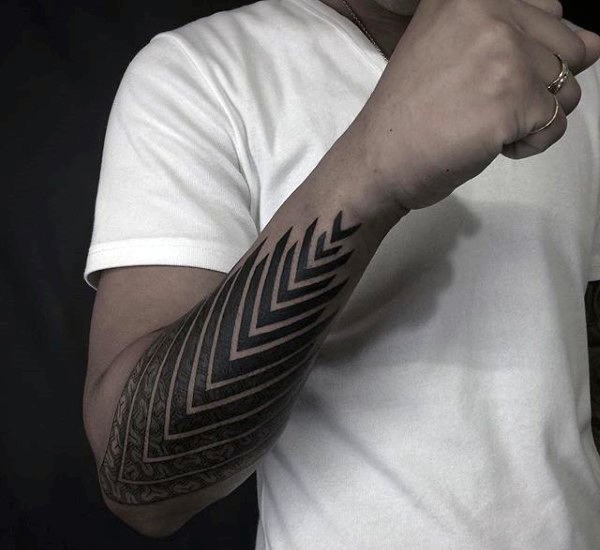 Usual dotwork style arm tattoo of arrow shaped ornament