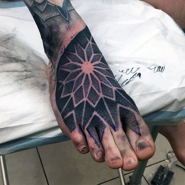 Usual dotwork style on foot tattoo of floral ornament