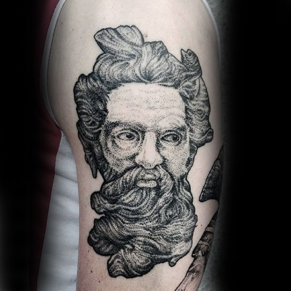 Usual dotwork style upper arm tattoo of ancient man portrait