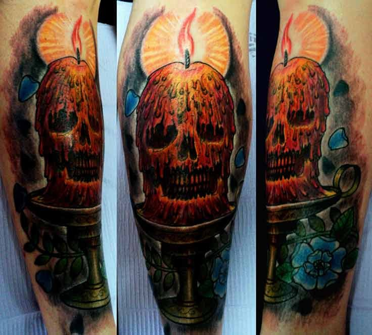 Usual illustrative style creepy looking human skull with candle and flower tattoo on arm