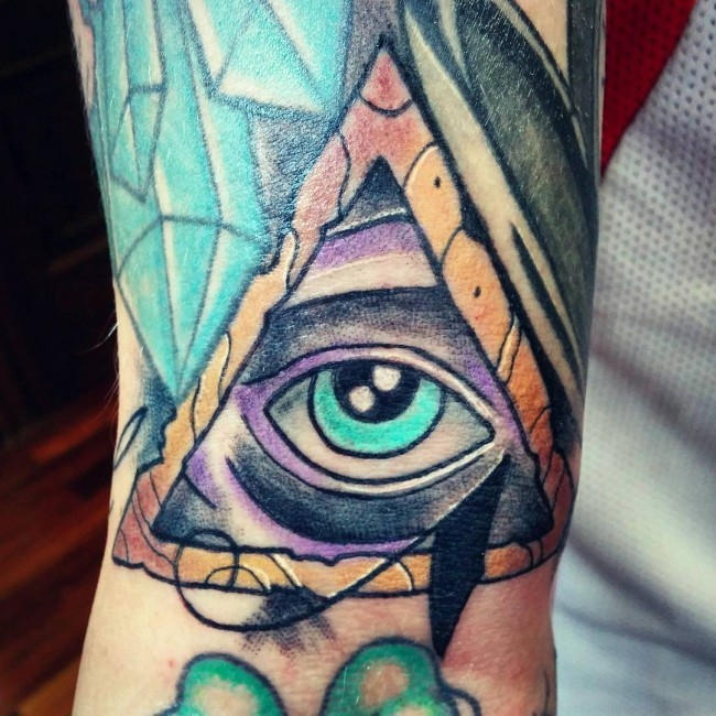 Usual multicolored triangle tattoo with mystic eye