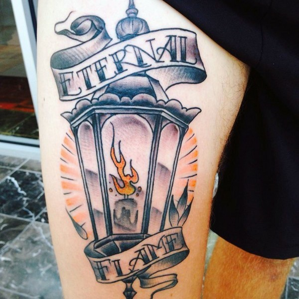 Usual old street lighter tattoo on arm combined with lettering