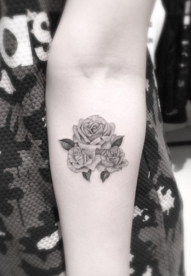Usual painted little black ink forearm tattoo of three rose flowers