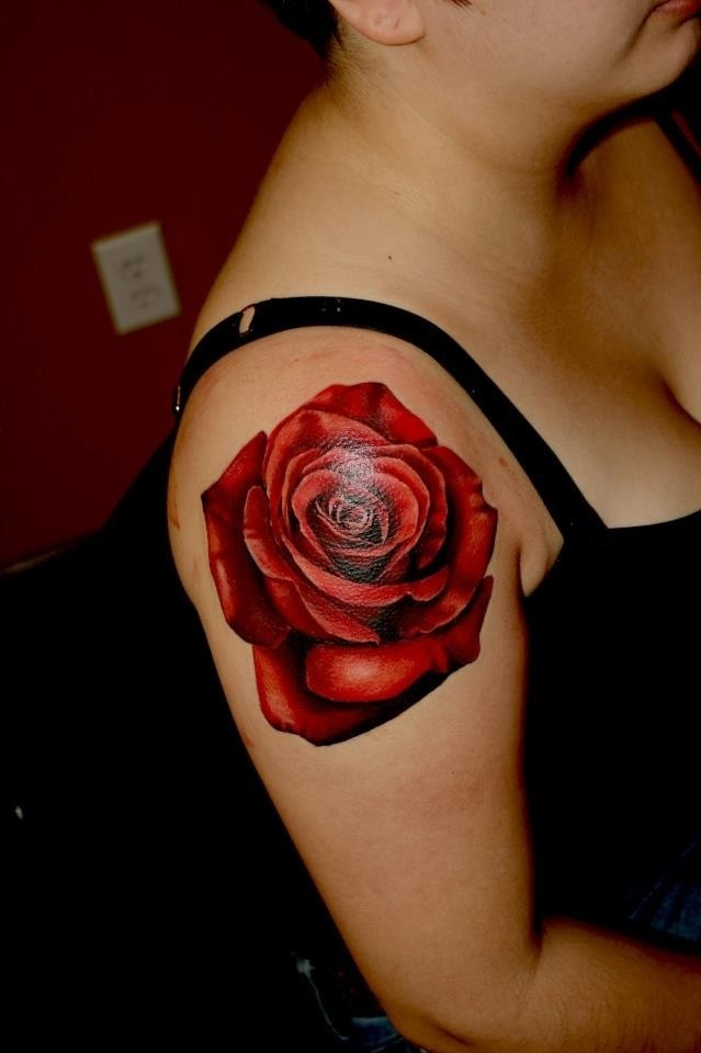 Usual red colored big rose tattoo on shoulder