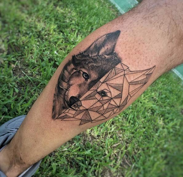 Usual separated realistic wolf tattoo with sketch wolf on leg