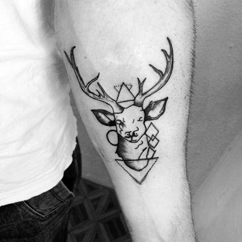 Usual style black ink deer head combined with geometrical figures tattoo on forearm zone