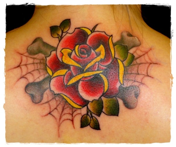 Usual style painted and colored big rose tattoo on upper back
