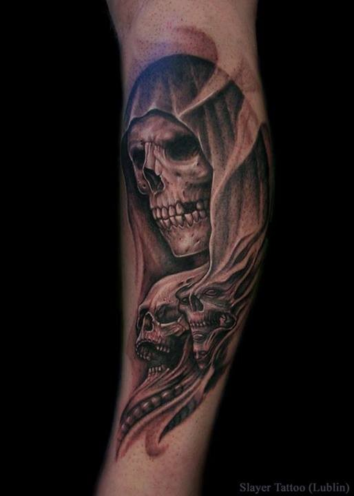 Various mystical black ink skulls tattoo on arm