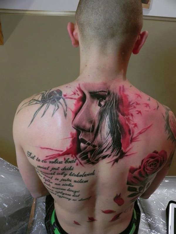 Various style painted multicolored tattoos with lettering on whole back