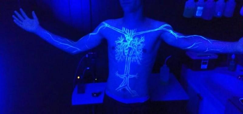 Very beautiful black light tree on the chest tattoo