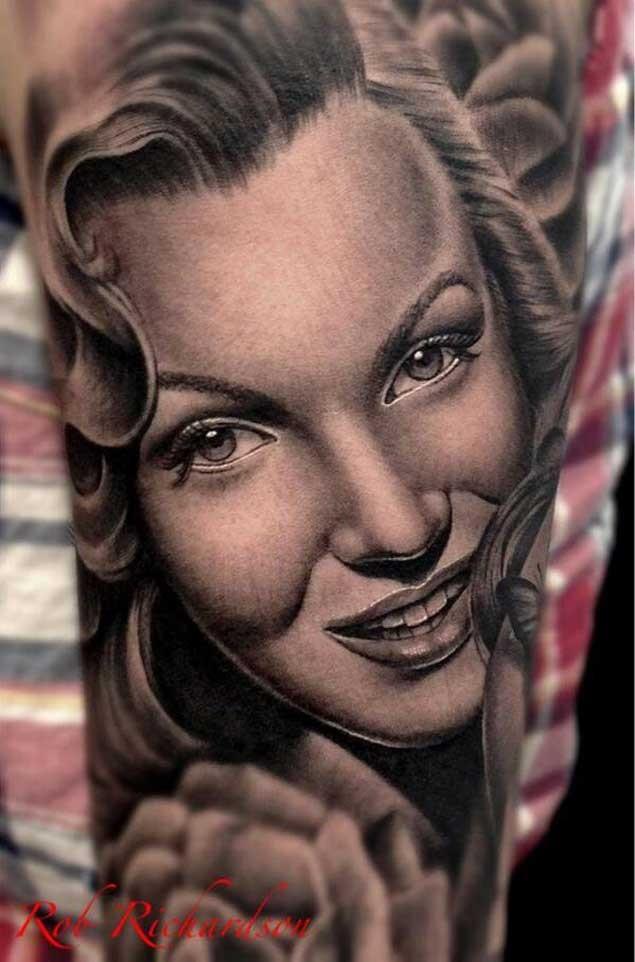 Very beautiful looking colored Merlin Monroe portrait tattoo