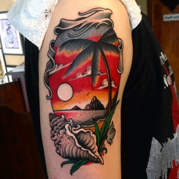 Very beautiful multicolored ocean beach with palm tree and shell tattoo on shoulder