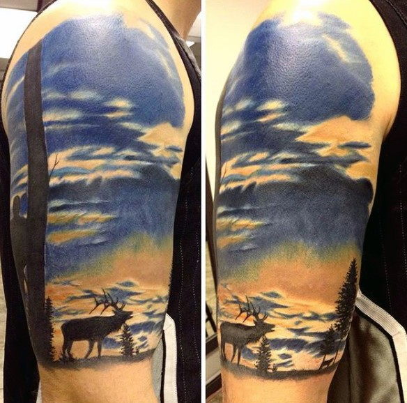 Very beautiful painted colorful wild life with deer half sleeve tattoo