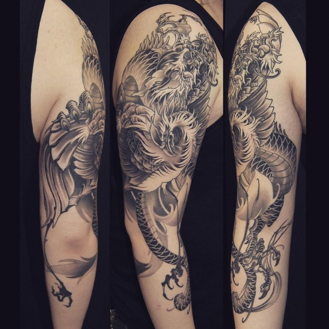 Very detailed black and white big half sleeve tattoo of Asian dragon
