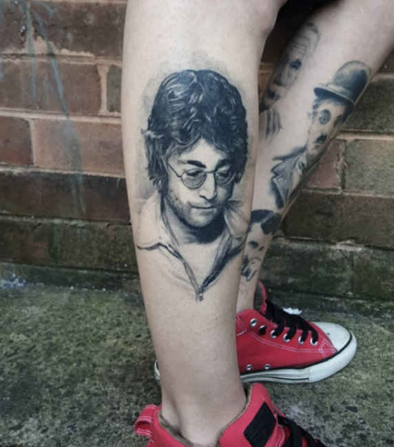 Very detailed black ink leg tattoo of famous musician portrait