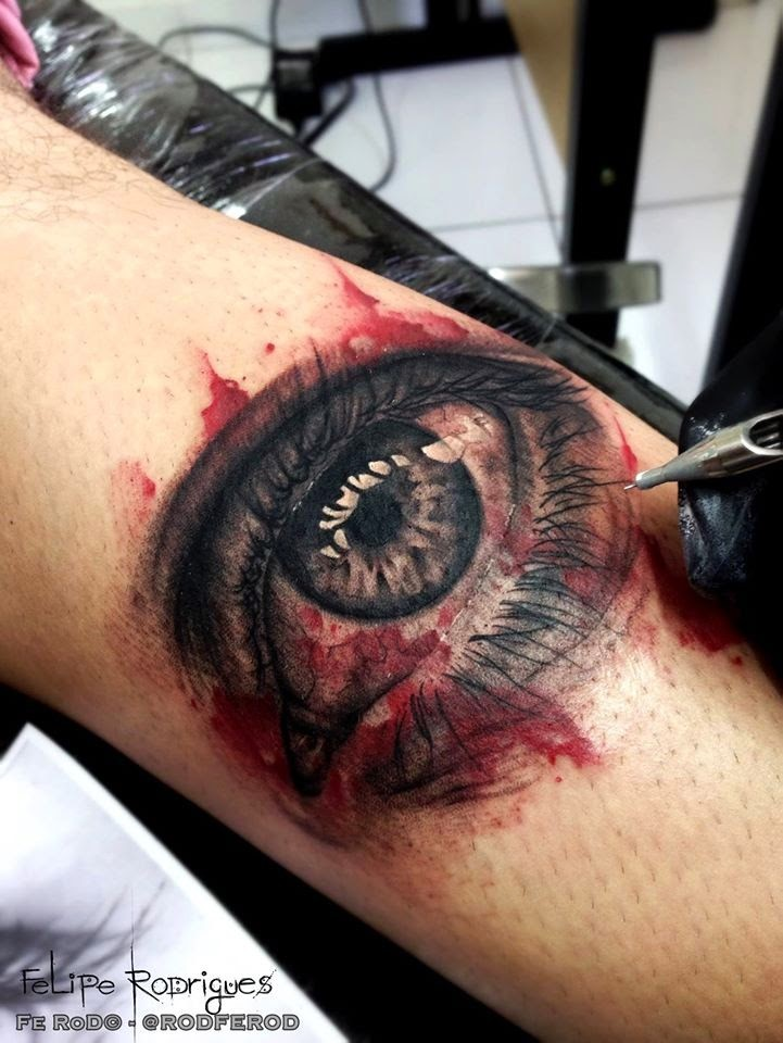 Very detailed leg tattoo of woman bloody eye