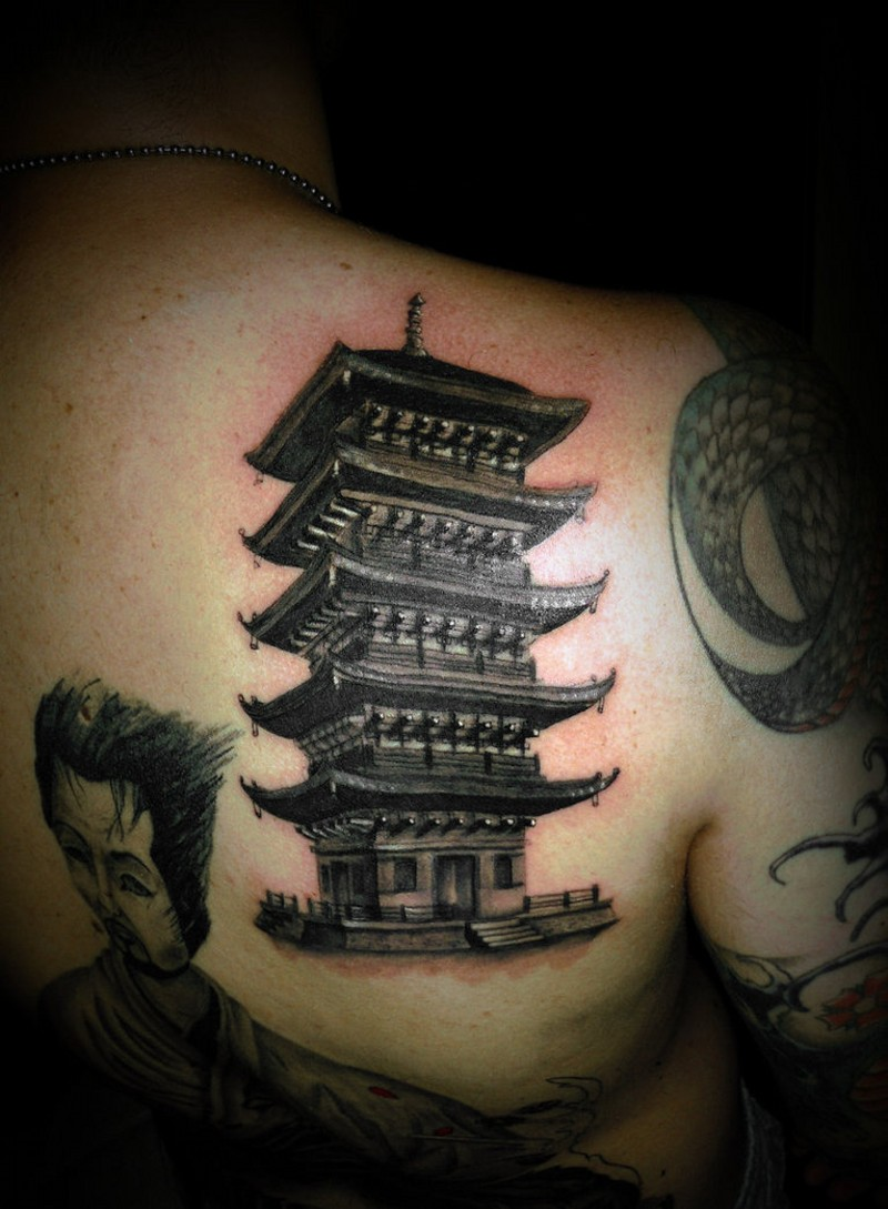 Very detailed looking black and white back tattoo of Asian temple