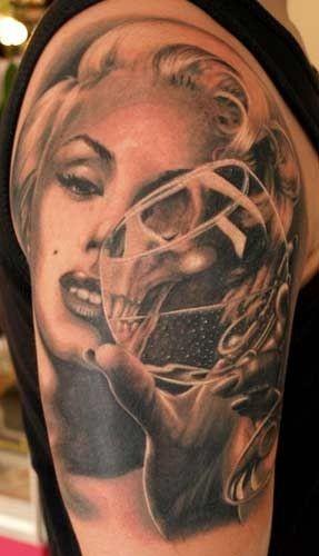 Very detailed massive black and white half skull half face original tattoo on shoulder