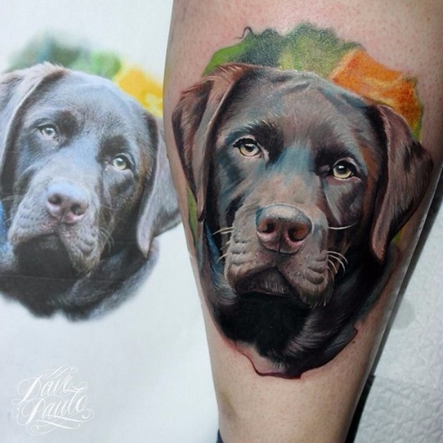 Very detailed natural looking dog portrait tattoo on leg muscle