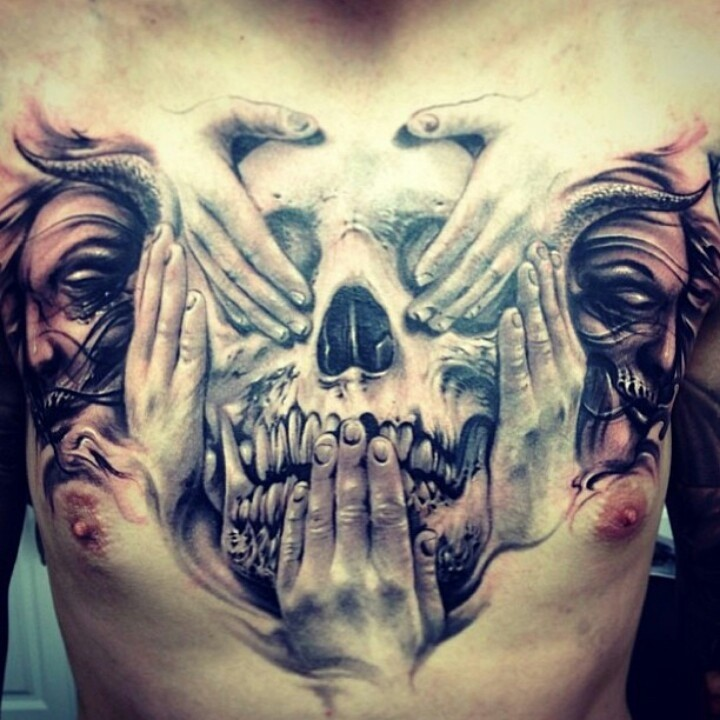 Very detailed natural looking mystical skull with hands tattoo on chest