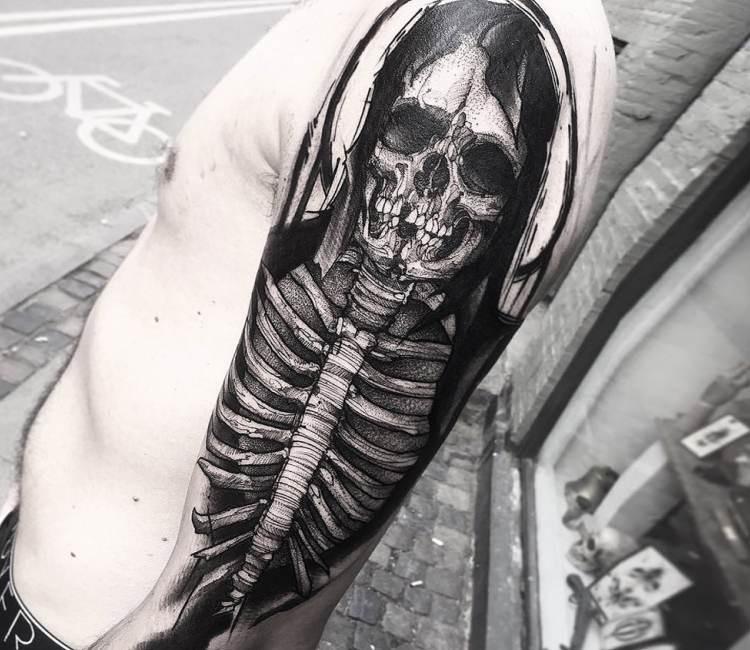 Very detailed realistic looking creepy human skeleton tattoo on forearm