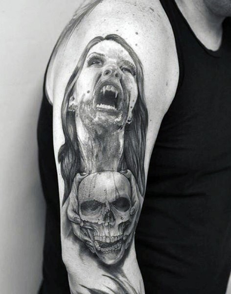 Very realistic black and white bloody vampire woman with skull tattoo on arm