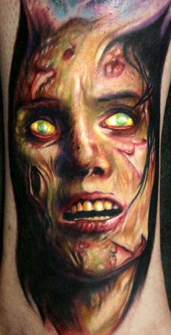 Very realistic colored creepy monster face tattoo on arm