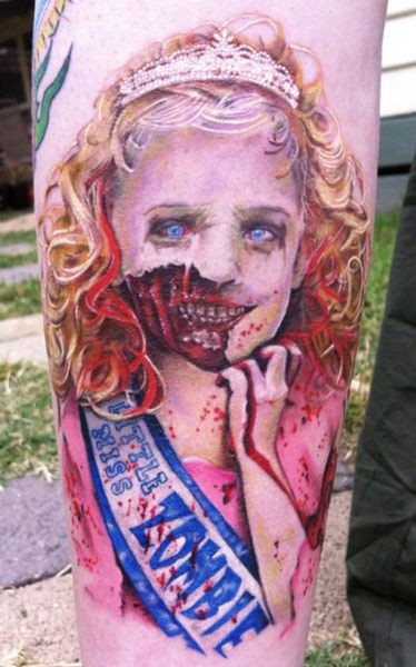 Very realistic horrifying monster girl colored tattoo on arm