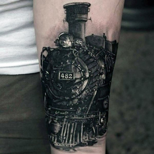 Very realistic looking amazing detailed colored old steamy train tattoo on arm