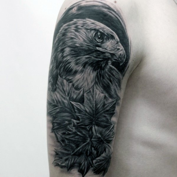 Very realistic looking awesome detailed black ink eagle half sleeve tattoo with maple leaves