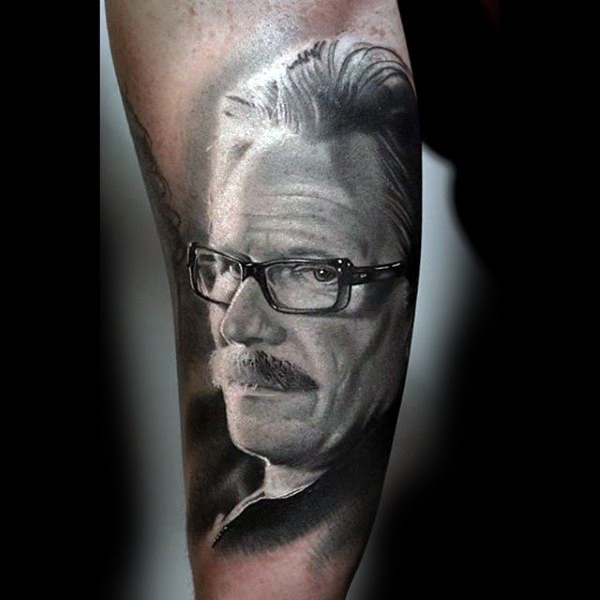 Very realistic looking Batman police detective tattoo on arm