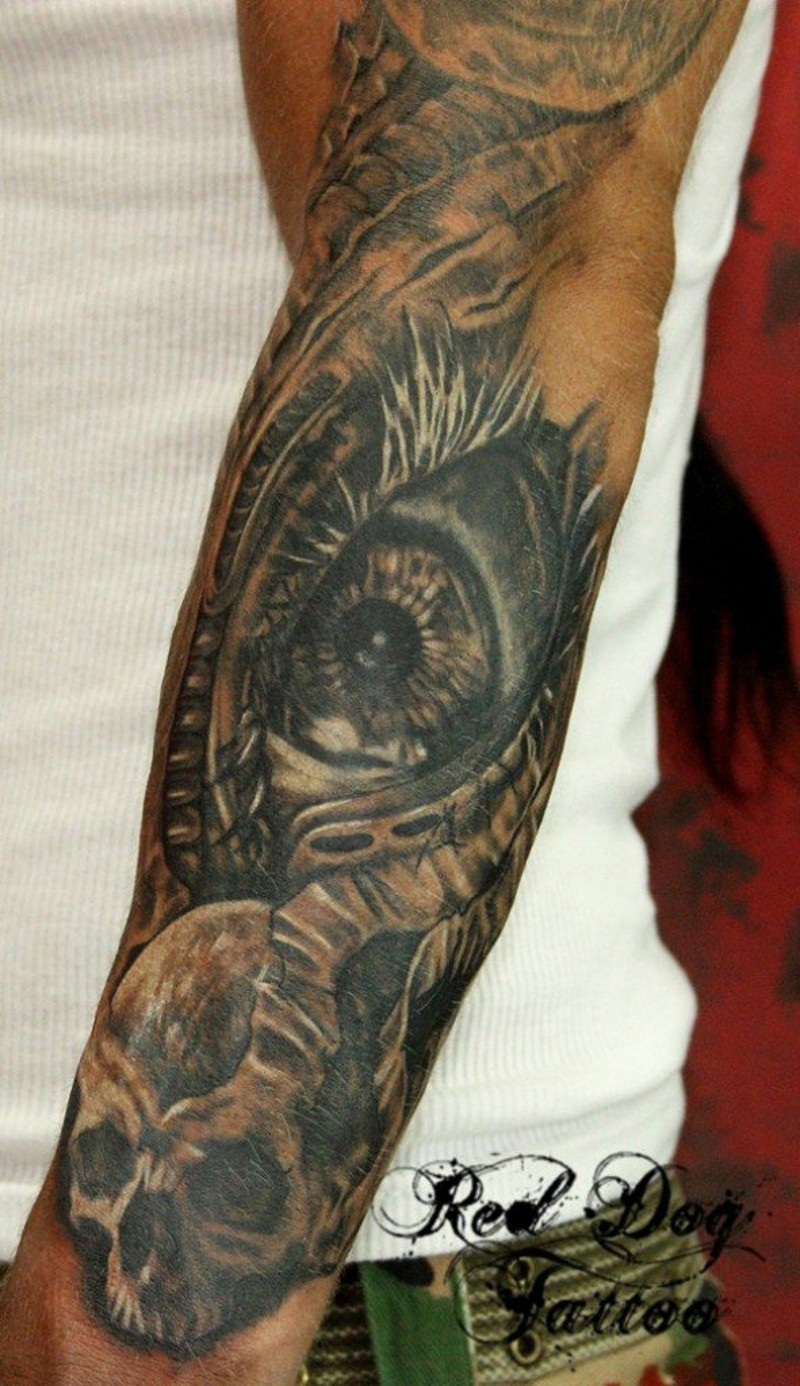 Very realistic looking big mystic eye with skull tattoo on arm