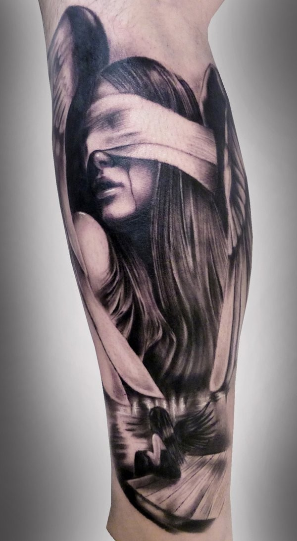 Very realistic looking black and white blind female angel tattoo on leg