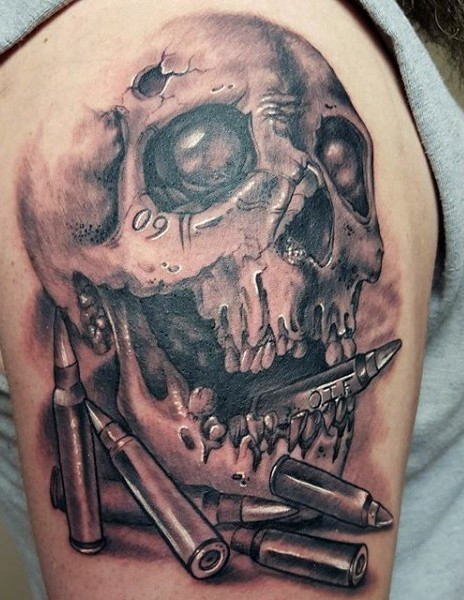 Very realistic looking black and white skull and bullets tattoo on upper arm