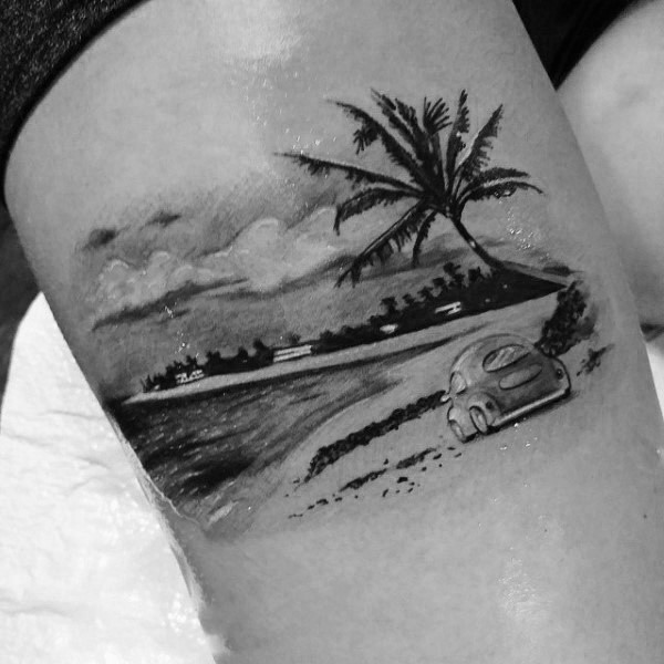 Very realistic looking black and white little car on shore with palm tree thigh tattoo