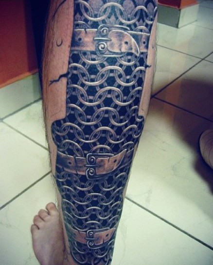 Very realistic looking black and white medieval chain armor tattoo on leg